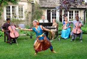 Anup Biswas (right cello)  with Soumita Roy (dancer) and Dipak Sapui (left cello) at Garden Buffet Supper and Soirée Musicale 5 June, 2010 , at Poulton House in Gloucestershire  During a fundraising tour of England and Scotland for the Mathieson Music Trust June/July 2010