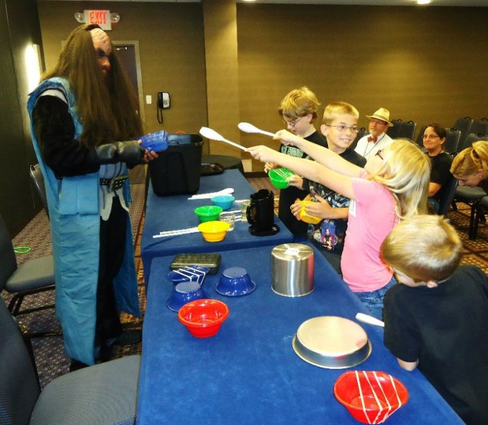 "Jon Silpayamanant teaching an ""Alien Music workshop for Kids"" at Cyphan Science-Fiction Convention in Chicago, Illinois."