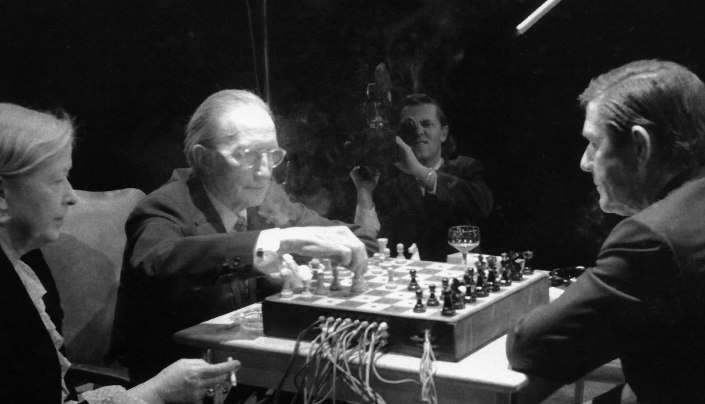 "John Cage & Marcel Duchamp performed ""Reunion"" at the Ryerson Theatre in Toronto on Tuesday March 5th, 1968.  The composition/concept was developed by Lowell Cross with pre-modulated photo-receptors that served as gating mechanisms to receive messages of movements and to transmit sound and light. Depending on the moves of the chess pieces, the sound was cut off or rerouted to generate a kind of random music by means of the pre-configured chance operation of the players."
