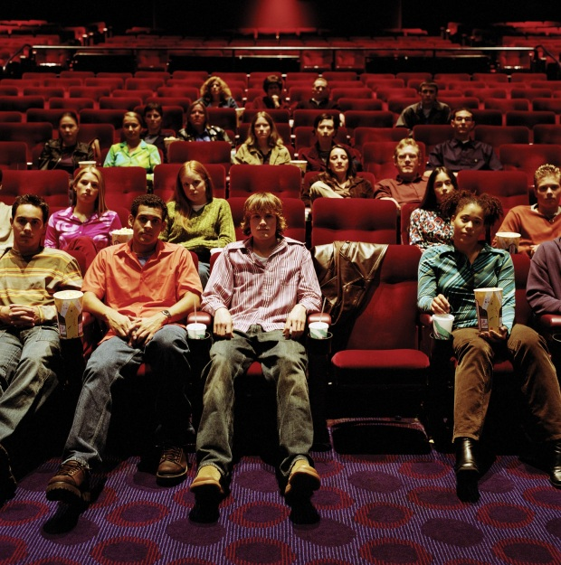 Audience sitting in a movie theater