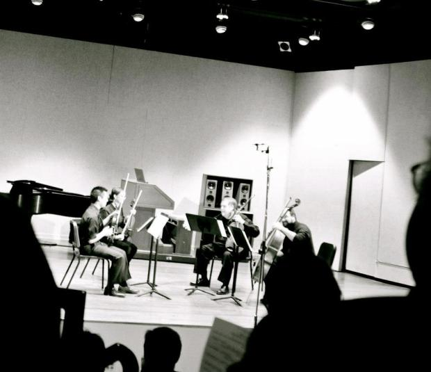 "Before playing Rachel Short's ""Scramble and Thrive"" for string quartet.  IU Southeast Recital Hall, 17 November 2012."