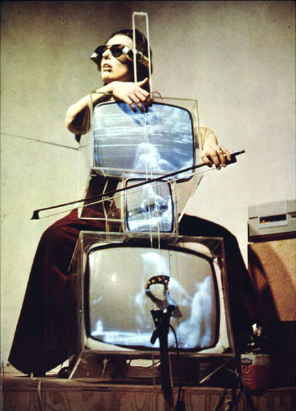 Charlotte Moorman playing Nam June Paik's TV Cello.