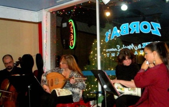 Jon Silpayamanant (left) performing with the Classical Arabic band, Ahel El Nagam, at Zorba's Greek and Middle Eastern Restaurant in Zionsville, Indiana. December 20, 2009