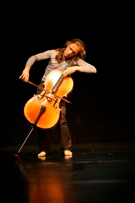 Barnaby Tree dancing while playing the cello.