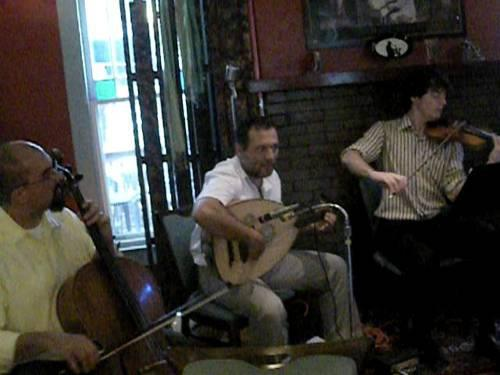 Jon Silpayamanant (left) playing with the Eastern Caravan Group at Cafe Django in Bloomington, Indiana.  September 4, 2011