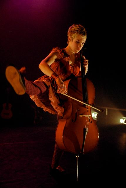 Laura Durrant dancing while playing the cello. Photo by Brian Hartley
