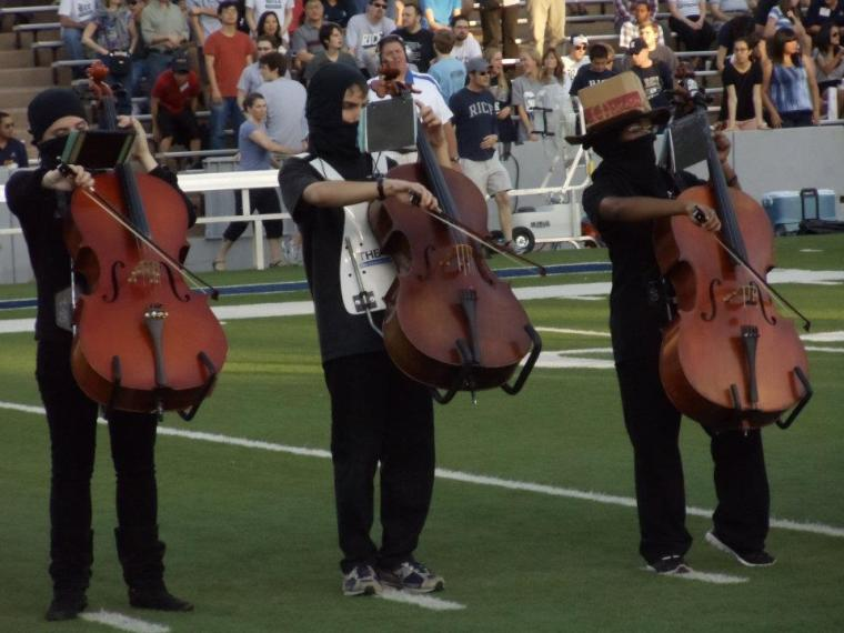 Cellists in Rice university Marching Owl Band.