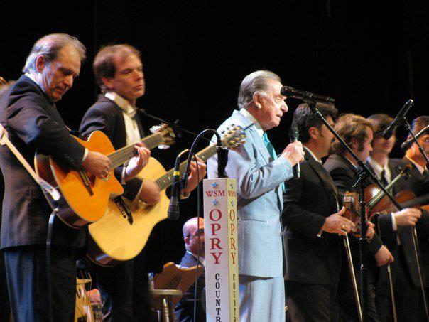Jon Silpayamanant playing for Multi Grammy Award winner, Ray Price (in blue).  Grammy Award winner, Bobby Flores (immediately right of Mr. Price) played fiddle.  The Grand Ole Opry in Nashville, TN.  October 1, 2009