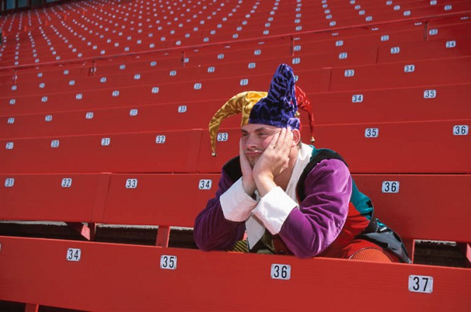 bored-jester-in-empty-stadium