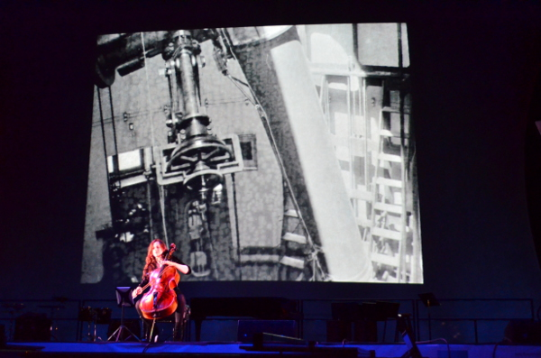 "Maya Beiser performing Michael Harrison's ""Just Ancient Loops"" with film by Bill Morrison"