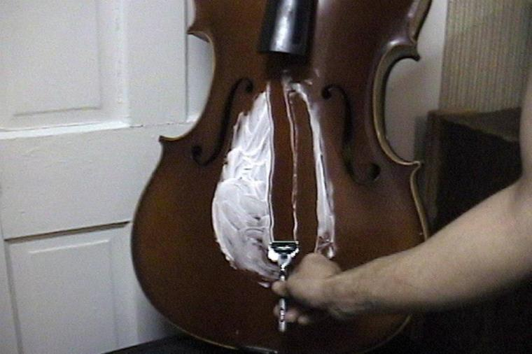 """Still from """"le violoncelle de Silpayamanant"""" Experimental video short from 2001. First shown during a live multimedia installation performance by Jon Silpayamanant at the Emerson Art Gallery, DePauw University in 2002."""