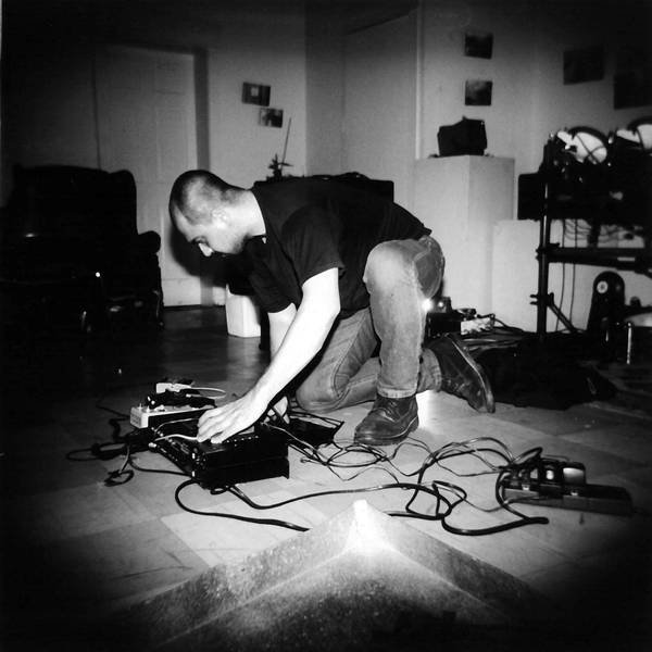 Jon Silpayamanant, aka Noiseman433, playing a set at the Lemp Neighborhood Arts Center in St. Louis, MO during the Rotten Piece 2003. May 09, 2003. photo by Carol Kelly