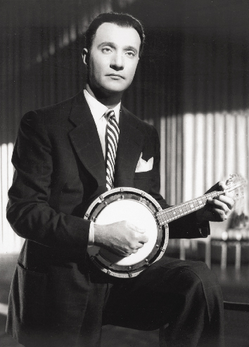 """Mohhamed Abdel Wahab, sometimes referrrred to as the """"Beethoven of the Arabic World,""""  with a Cümbüş."""