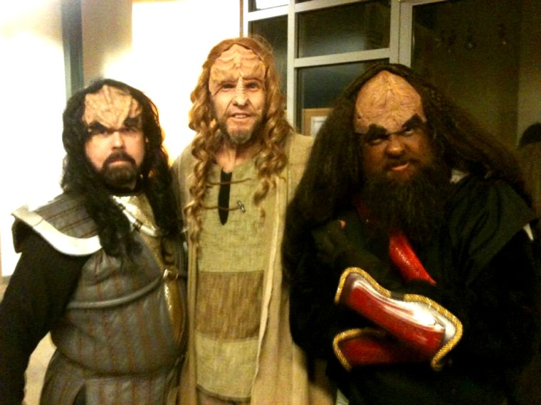 Members of bomwI'pu' (the il Troubadore Klingon Music Project) with SQuja' at the Cincinnati Klingon Christmas Carol