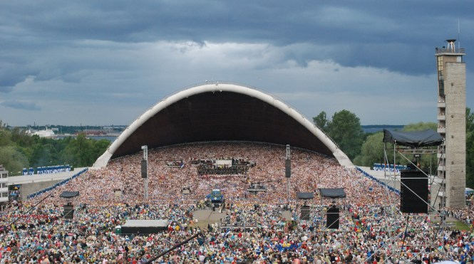 An Estonian Choir numbering 30,000 participants performing to an audience of 80,000 at the 25th Estonian Song Festival