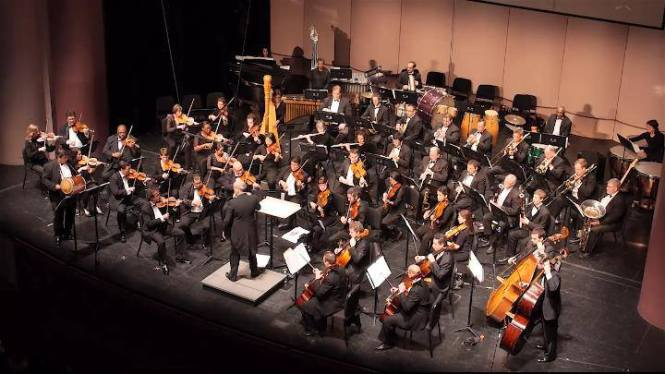 Miguel Castro, Tambora, performing with the Houston Latin American Philharmonic.