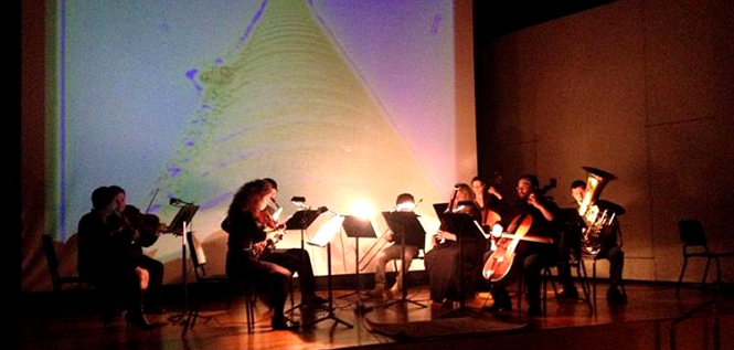 "The Mothership Ensemble performing Louis Andriessen's ""Worker's Union"" at IU Southeast's Steifler Recital Hall on March 15, 2014. Interactive video projections by Roxell Karr."