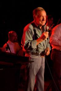 Jon Silpayamanant performing with multi-Grammy Award winner, Ray Price, as a headlining act with Willie Nelson and Merle Haggard at Carl's Corner, Texas.