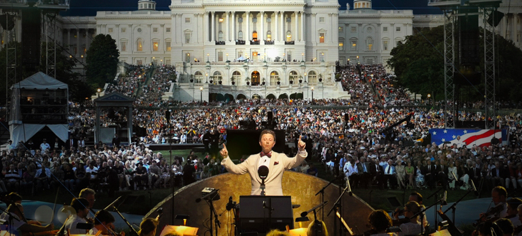 "The National Symphony Orchestra performs at ""A Capitol Fourth"" on the West Lawn of the Whitehouse. The event averages 700,000--just shy of the 800,000 in attendance at the New York Philharmonic's attendance during their Liberty Weekend performance in 1986 (see top blog image)."